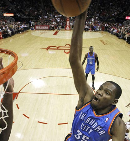 Kevin Durant skies to throw down a thunderous dunk, leading the Thunder with 30 points.  (AP)