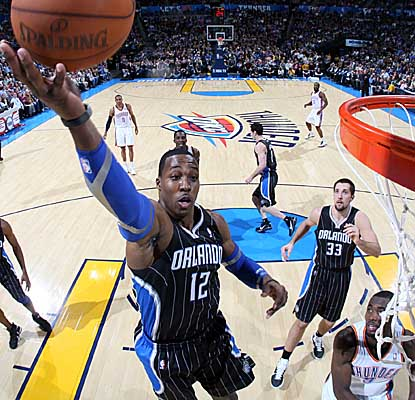 Dwight Howard reaches for one of his 18 rebounds Thursday in the Magic's loss to the Thunder. (AP)
