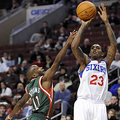 Sixers guard Lou Williams shoots over Earl Boykins of the Bucks. Williams was the hero for Philly.  (AP)