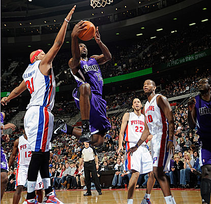 Tyreke Evans gets past Pistons defenders in the lane, finishing with a game-high 25 points. (Getty Images)
