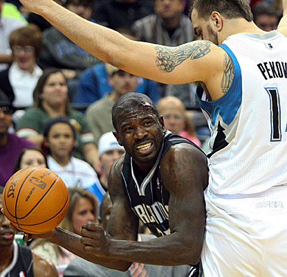 Jason Richardson works past Wolves center Nikola Pekovic on Saturday as the Magic get a road win. (US Presswire)