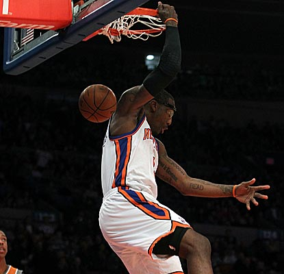 Amar'e Stoudemire gets two on the reverse, scoring a game-high 41 points in the Knicks' loss. (Getty Images)