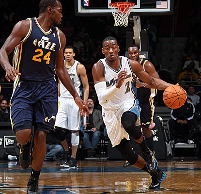 John Wall drives downcourt vs. the Jazz, scoring 19 points and dishing 15 assists in the home win. (Getty Images)
