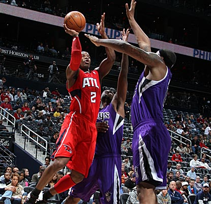 Joe Johnson shoots amidst Kings defenders Monday, scoring a game-high 36 points in Atlanta's win. (Getty Images)