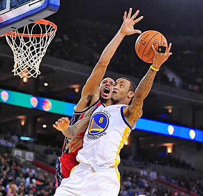 Monta Ellis drives for two of his 26 points, and the Warriors win their sixth straight over the Nets. (US Presswire)