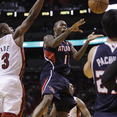 Jamal Crawford comes off the bench and scores 19 for the Hawks during a win over a Bosh-less Heat squad.  (AP)