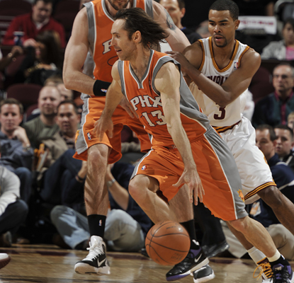 Steve Nash drives past Ramon Sessions of the Cavaliers on his way to 15 points and 15 assists.  (Getty Images)