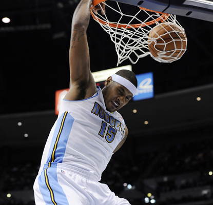 Carmelo Anthony dunks for two of his 35 points against the Thunder as the Nuggets win. (AP)