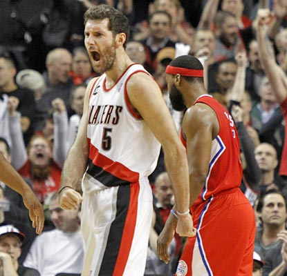 Rudy Fernandez gets in on the action with 17 points off the bench, one of five Blazers in double digits. (AP)