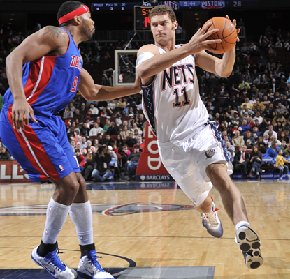 Brook Lopez drives past Chris Wilcox of the Pistons on his way to scoring 15 points in the Nets' win. (Getty Images)