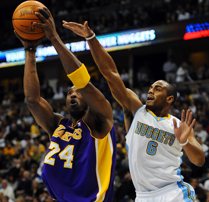 Nuggets guard Arron Afflalo tries to slow down Kobe Bryant, who goes on to lead the Lakers with 18 points. (AP)