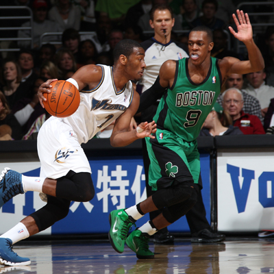 John Wall drives around Rajon Rondo while leading the Wizards back from a 16-point deficit to defeat the Celtics.  (Getty Images)