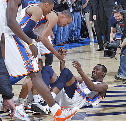 Kevin Durant's teammates mob him after his game-winning shot erased a six-point deficit in the final three minutes. (Getty Images)