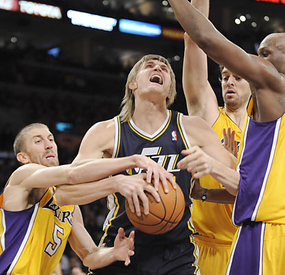 Andrei Kirilenko and the Jazz fail to get going against the Lakers, who muster out their seventh straight win at home.  (AP)