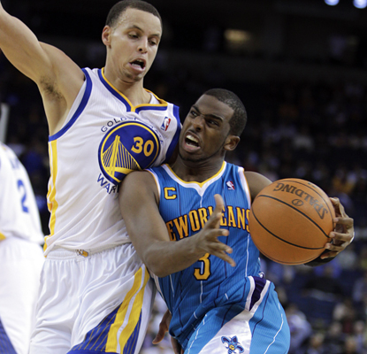 Stephen Curry (left) tries to slow Chris Paul down, but Paul finishes with 18 points and 17 assists. (AP)