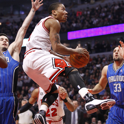 Despite playing with two stomach ulcers, Derrick Rose scores 22 and leads the Bulls to a important win over the Magic. (US Presswire)