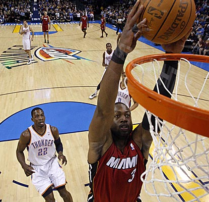 Dwyane Wade slams home a dunk in Oklahoma City, scoring 32 points in Miami's win. (AP)