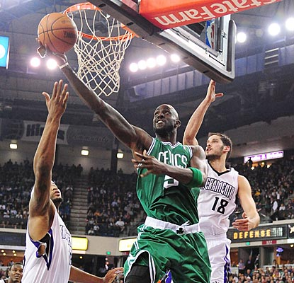 Kevin Garnett blows by Omri Casspi (18) in the second quarter and helps the Celtics wrap up a successful four-game road trip.  (US Presswire)
