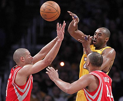 Kobe Bryant makes sure his teammates get involved in the first quarter, registering seven assists and zero points.  (AP)