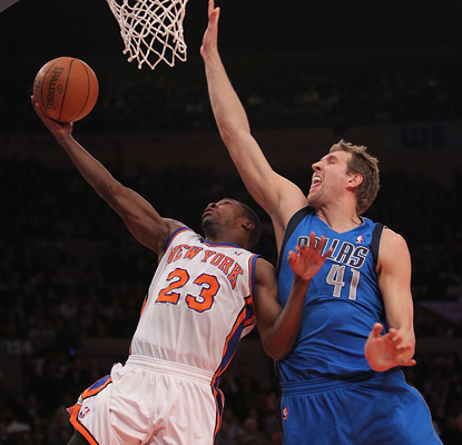 Dirk Nowitzki, right, plays defense on Toney Douglas and contributes 29 points and 11 rebounds. (Getty Images)