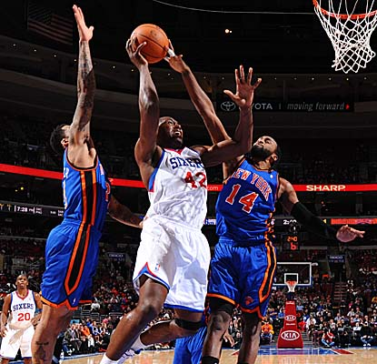 Sixers big man Elton Brand splits Knicks defenders for a bank shot Friday in Philly. (Getty Images)