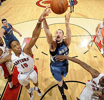 Kevin Love reaches for one of his 15 rebounds in the Wolves' loss in Toronto on Friday. (Getty Images)