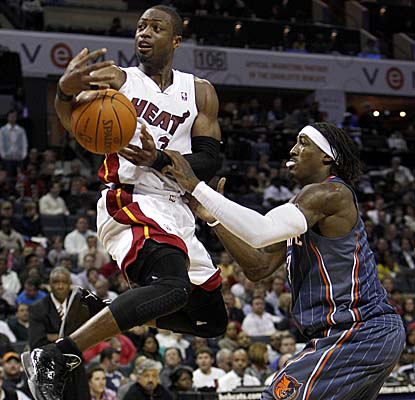 Dwyane Wade is fouled by Bobcats F Gerald Wallace in the Heat's win Friday. (AP)