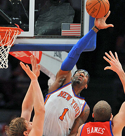 New York's Amar'e Stoudemire blocks Spencer Hawes' shot and also scores a game-high 41 points. (AP)
