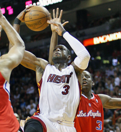 The Heat's Dwyane Wade goes up for two of his game-leading 28 points against the Clippers. (AP)