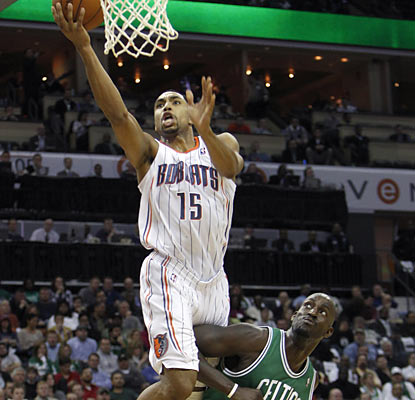 Gerald Henderson, who scores 15 points off the bench, goes up for a basket as Kevin Garnett jockeys for position. (AP)