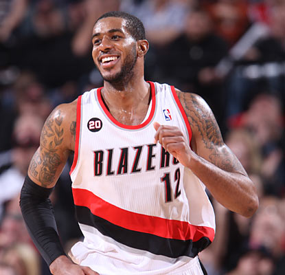 LaMarcus Aldridge can't help but enjoy his career night as he helps the short-handed Blazers take down the Bulls. (Getty Images)