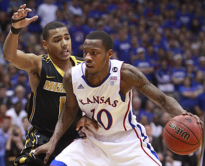 Kansas' Tyshawn Taylor, who winds up with 13 points, works against Missouri's Phil Pressey in the first half.  (AP)