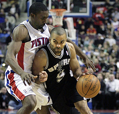 Tony Parker, shown working against Ben Gordon, hands out seven assists and makes all but one of his eight field-goal attempts.  (AP)