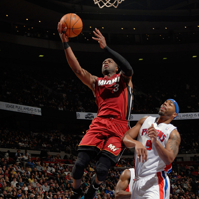 Dwyane Wade scores two of his game-high 24 on this silky layup against the Pistons'  Chris Wilcox. (Getty Images)