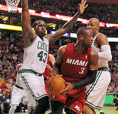 Kendrick Perkins, Ray Allen and Boston's swarming D limit Dwyane Wade to 16 points on 6-of-17 shooting.  (US Presswire)