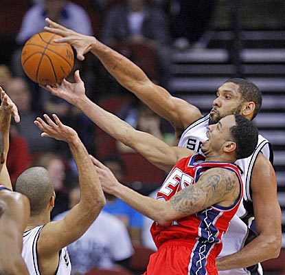 Tim Duncan stuffs the shot of Devin Harris, and finishes with 15 points and 11 boards in the Spurs' win. (US Presswire)
