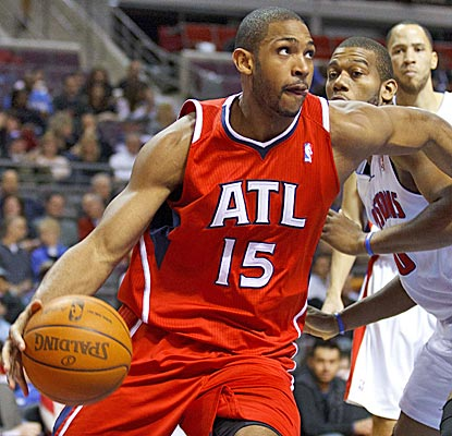 Al Horford, blowing past the Pistons' Greg Monroe for two of his 10 points, helps the Hawks rally from 15 down. (US Presswire)