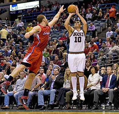 Carlos Delfino shoots over Blake Griffin for one of his seven 3-pointers as the Bucks roll to a 24-point win. (US Presswire)