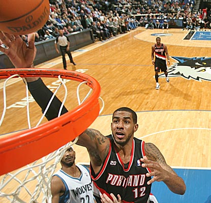 LaMarcus Aldridge drops in two of his 21 points in the Blazers' 14-point win in Minneapolis. (Getty Images)