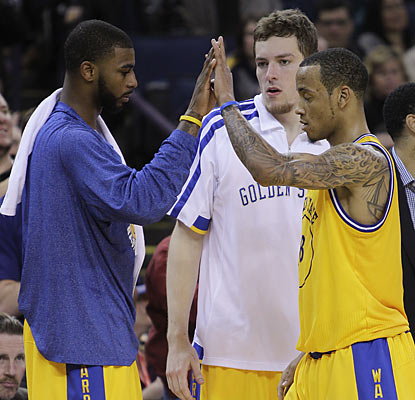 Dorell Wright, David Lee and Monta Ellis combine for 53 of the Warriors' 102 points in the comeback against the Hornets.  (AP)