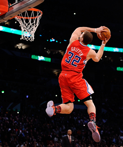 Blake Griffin slams home a difficult reverse 360 in the first round. (Getty Images)