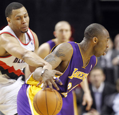 Brandon Roy, seeing his first game action since Dec. 15, plays in a limited role against Kobe and the Lakers.  (AP)