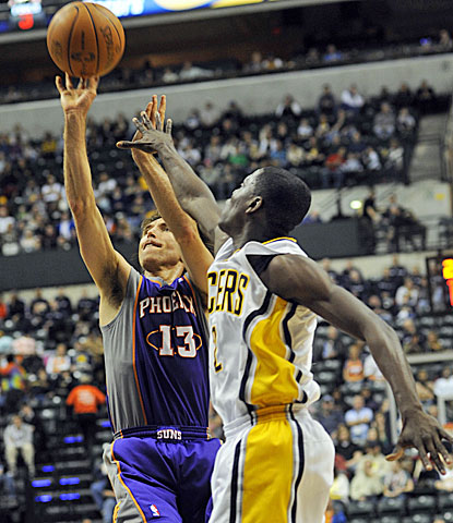 Suns guard Steve Nash shoots over Pacers point man Darren Collison on Sunday afternoon.  (AP)