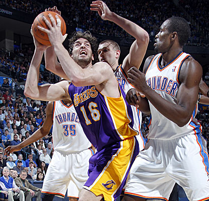 Pau Gasol powers through Thunder defenders, scoring a team-high 18 points for the Lakers. (Getty Images)