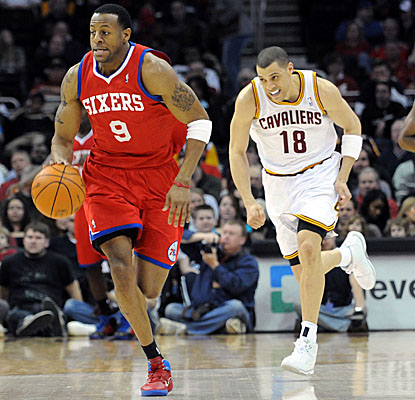 Sixers guard Andre Iguodala drives on the fast break after a steal vs. the Cavaliers. (Getty Images)