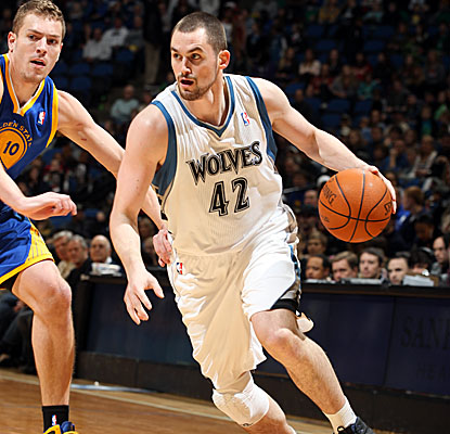Kevin Love drives to the hoop, aiding Minnesota's win with 37 points and 23 boards. (Getty Images)