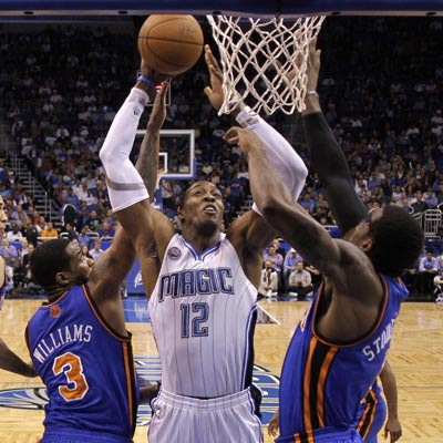 Dwight Howard scores 22 of 30 points in the first half against the new-look Knicks. (Getty Images)