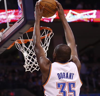 Kevin Durant puts in 21 points in 26 minutes of action before leaving the game with a sprained left ankle.  (AP)