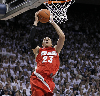 New Mexico guard Phillip McDonald goes up for a basket as he leads the Lobos to an upset over BYU with 26 points. (AP)