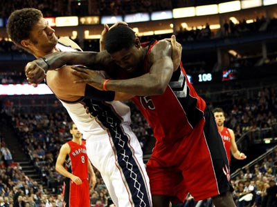 Tempers flare in London as Brock Lopez (left) scores 25 points and leads the Nets to victory over the Raptors. (Getty Images)